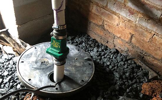 crawl space waterproofing french drain sump pump basin